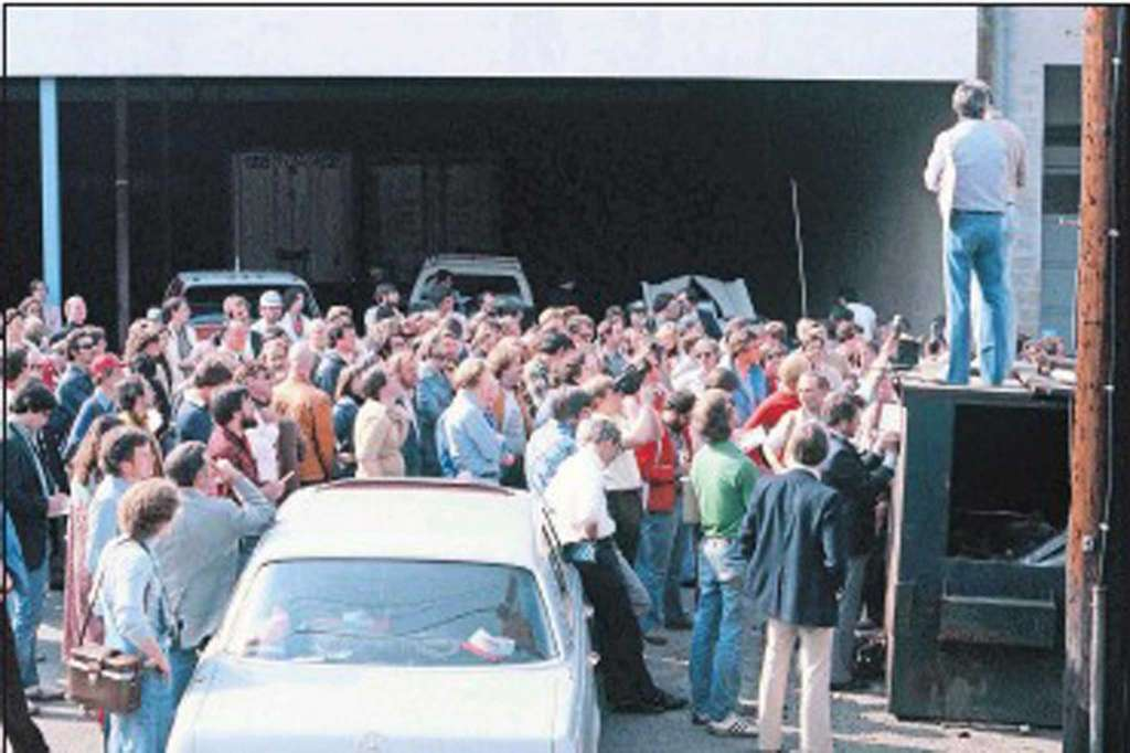 The start of the 1979 Cannonball from behind the Lock, Stock and Barrel Pub in Darien CT. Brock Yates addresses the participants from atop the dumpster