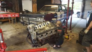 Matt Happel of Sloppy Mechanics working his magic on the Arne's Antics Bluesmobile